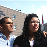 """I compare myself to a turtle"" says Arquianys Martinez, 15. <br /> She will receive her high school diploma from Lawrence High School on June7/2009. <br /> <br /> Arguianys, originally from Dominican Republic came to US when she was 8 years old.<br /> <br /> She managed to learned English while enrolled in several after-school programs. This photo shows her along with Arquimedes Martinez, her father."