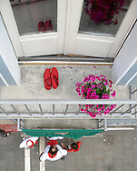 A red shoes are pictured in a balkony during the San Fermin Festival on July 7 2014, in Pamplona, Basque Country. Every year, tens of thousands of people pack Pamplona's streets for a drunken kick-off to one os worls's best-known fiesta: the nine-day San Fermin bull-running festival. (Ander Gillenea / Bostok Photo)