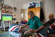 Tony Gee, 30 years a Somers Town tennent,  with Rennie Greendidge, at his appartment on 1st July 2016 in London, United Kingdom. Somers Town, a district in north west London, is a large housing estate nestled between Euston, St Pancras and Kings Cross Library. Predominantly filled with social housing for the past 200 years, much of the area's housing was built in the twentieth century by the local authority.