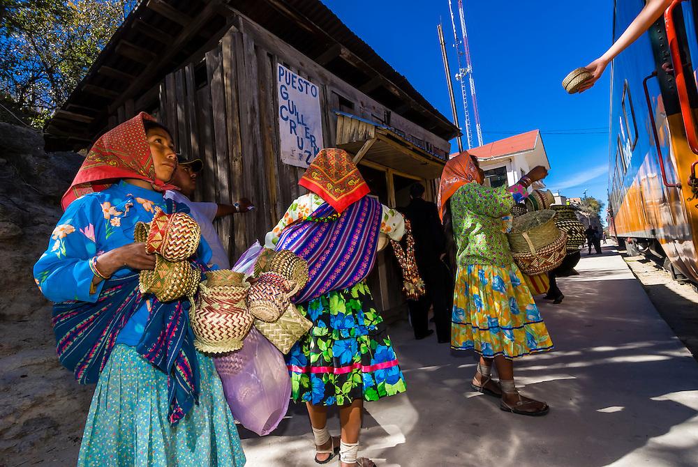 Tarahumara Indian women selling handwoven baskets at the CHEPE (Chihuahua al Pacifico) train, stopped at San Rafael, Copper Canyon, Mexico