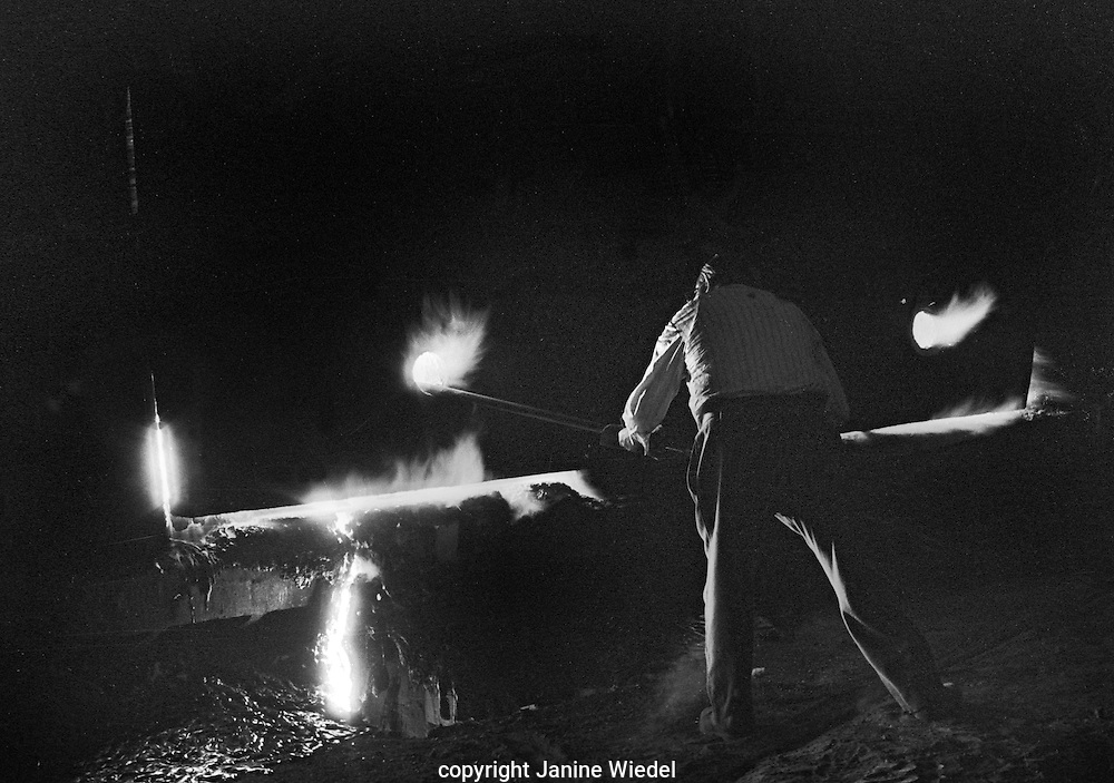 Bill Blitz Barrington inserts a temperature recorder into an open hearth furnace.The melting shop at Bilston Steelworks in the Black Country West Midlands in the 1978