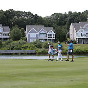 Bubba Watson, USA, walks past housing on the golf course during the second round of the Travelers Championship at the TPC River Highlands, Cromwell, Connecticut, USA. 20th June 2014. Photo Tim Clayton