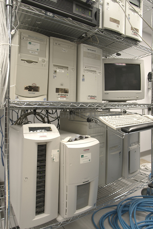 Computer server room with tangle of wires and computer racks