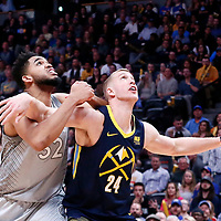 05 April 2018: Minnesota Timberwolves center Karl-Anthony Towns (32) vies for the rebound with Denver Nuggets center Mason Plumlee (24) during the Denver Nuggets 100-96 victory over the Minnesota Timberwolves, at the Pepsi Center, Denver, Colorado, USA.
