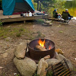 A campfire warms a waterfront campsite at Lake Francis State Park in Pittsburg, New Hampshire.