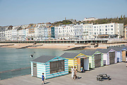 Brightly coloured beach huts on Hastings Pier on the 20th April 2019 in Hastings in the United Kingdom.