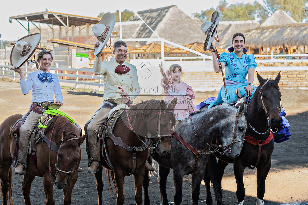 Members of the famous Franco Family of charros greet the audience at the family Charreria practice session in the Jalisco Highlands town of Capilla de Guadalupe, Mexico. The Franco family has dominated Mexican rodeo for 40-years and has won three national championships, five second places and five third places. Left to right are: Juan Franco de Anda, Juan Franco Gonzalez, Analia Franco de Anda and Saray Franco de Anda,