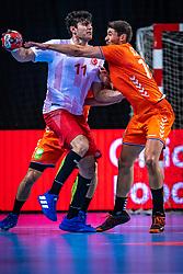 The Dutch handball player Doruk Pehlivan, Robin Schoenaker in action during the European Championship qualifying match against Turkey in the Topsport Center Almere.