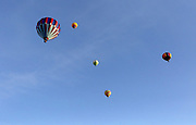 Hot air balloons dot the sky above Howard Tietan Park in Walla Walla, Wa.  More than 30 hot air balloons lift off a few minutes after sunrise for the 41st annual Balloon Stampede.  <br /> <br /> Greg Gilbert / The Seattle Times