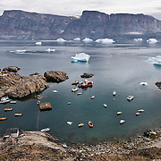 The boat harbor of the small fising village known as Uummannaq, Greenland.