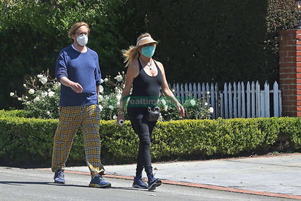 EXCLUSIVE: Kate Hudson and her husband head out on a walk with their kids and Kate's mother Goldie Hawn. 11 Apr 2020 Pictured: Kate Hudson. Photo credit: P&P / MEGA TheMegaAgency.com +1 888 505 6342