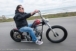 "Chris Wade riding his custom 1953 Harley-Davidson Panhead ""Supafly"" north on AIA toward Flagler Beach during Daytona Beach Bike Week. FL. USA. Tuesday, March 14, 2017. Photography ©2017 Michael Lichter."