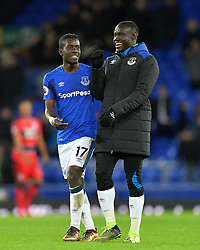 """Everton's Idrissa Gueye (left) and team-mate Oumar Niasse after the Premier League match at Goodison Park, Liverpool. PRESS ASSOCIATION Photo Picture date: Saturday December 2, 2017. See PA story SOCCER Everton. Photo credit should read: Dave Howarth/PA Wire. RESTRICTIONS: EDITORIAL USE ONLY No use with unauthorised audio, video, data, fixture lists, club/league logos or """"live"""" services. Online in-match use limited to 75 images, no video emulation. No use in betting, games or single club/league/player publications."""