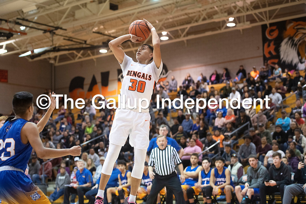 Gallup Bengal Joaquin Ortega (30) takes a jump shot against the Bloomfield Bobcats Friday night at Gallup High School in Gallup. The Bengals took the win 78-56.