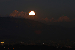 November 14, 2016 - Kathmandu, Nepal - The super moon appears from behind a mountain range in Kathmandu, Nepal on Monday, November 14, 2016. (Credit Image: © Skanda Gautam via ZUMA Wire)