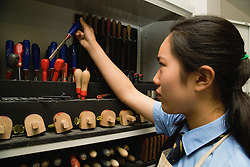 Secondary school student selecting tools to use in a woodwork lesson,