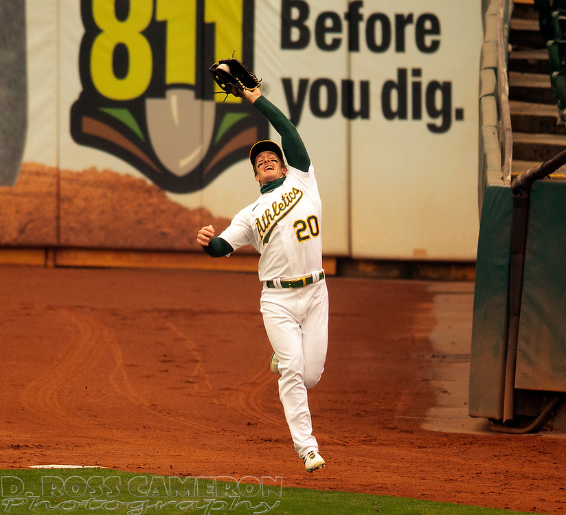 Sep 10, 2020; Oakland, California, USA; Oakland Athletics right fielder Mark Canha (20) makes a running catch of a foul popup off the bat of Houston Astros Alex Bregman (2) during the first inning of a baseball game at Oakland Coliseum. Mandatory Credit: D. Ross Cameron-USA TODAY Sports