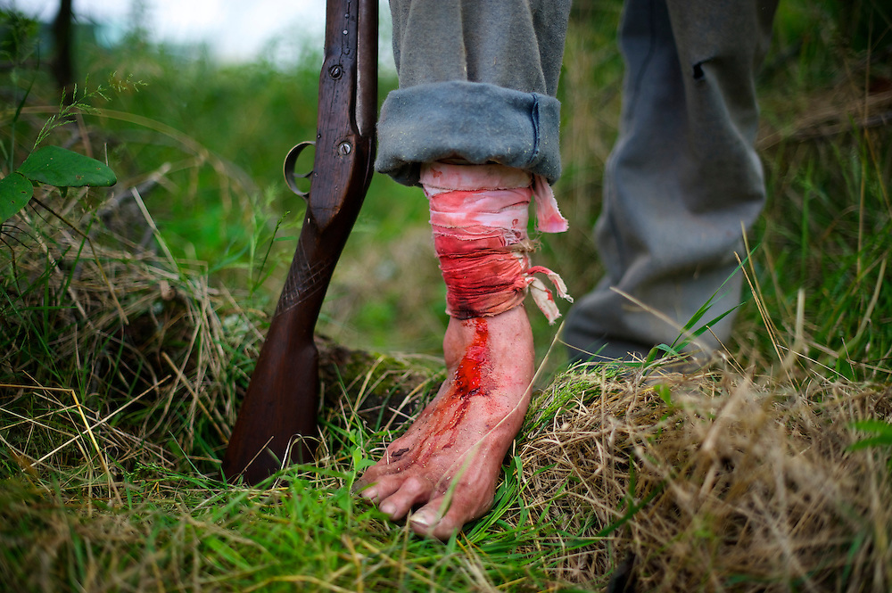 A Union soldier displays a costume wound after Pickett's Charge reenactment at the finale of the Blue Gray Alliance events marking the 150th anniversary of the Battle of Gettysburg, in Gettysburg, Pennsylvania June 30, 2013.