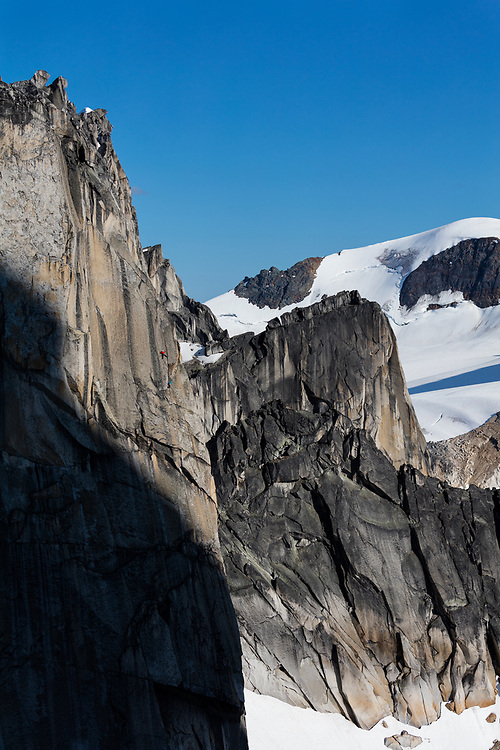 Jon Walsh and Michelle Kadatz climbing a new alpine granite route on the Gar Wall in East Creek, Bugaboo Provincial Park