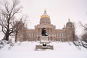 26 JANUARY 2021 - DES MOINES, IOWA: The Iowa State Capitol after a storm dropped a record amount of snow. Workers in Des Moines started cleaning up a record snowfall Tuesday morning. The National Weather Service reports that 10.3 inches of snow fell at Des Moines International Airport Monday, January 25, breaking the daily record of 10 inches for January 25 set in 1895. Many downtown businesses closed for the day because of the snow, since roads throughout central Iowa were snowpacked and hard to drive.        PHOTO BY JACK KURTZ