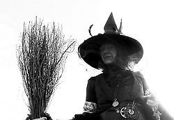 © Licensed to London News Pictures.01/11/15<br /> Whitby, UK. <br /> <br /> A woman comes dressed as a witch to the Whitby Goth weekend in Whitby, North Yorkshire. The event began in 1994 to celebrate goth culture and music and takes place twice each year. <br /> Thousands of extravagantly dressed people attend the popular event wearing Steampunk, Cybergoth, Romanticism, Victoriana and other clothing as they take part in the celebration of Goth culture. <br /> <br /> Note to Editors - Picture shot on Kodak Tri X 400ISO film.<br /> Photo credit : Ian Forsyth/LNP