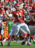 KANSAS CITY, MO - SEPTEMBER 29:  Quarterback Alex Smith #11 of the Kansas City Chiefs throws a pass down field against the New York Giants during the first half on September 29, 2013 at Arrowhead Stadium in Kansas City, Missouri.  (Photo by Peter Aiken/Getty Images) *** Local Caption *** Alex Smith