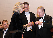 Dr. Burt Saidel (right) presents guest conductor Joanie Haverstick with one of his hand crafted batons to use during the 12th Annual ArtsGala at Wright State University's Creative Arts Center, Saturday, April 2, 2011.