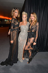Left to right, JOURDAN DUNN, RITA ORA and CARA DELEVINGNE at the GQ Men Of The Year 2014 Awards in association with Hugo Boss held at The Royal Opera House, London on 2nd September 2014.