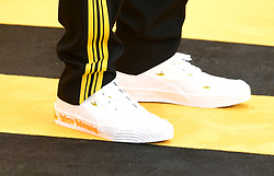 Close up of a pair of Yellow Submarines shoes during the Yesterday UK Premiere held in London, UK.