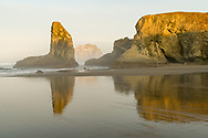 Sunrise and Wizard's Cap on Bandon Beach, OR.