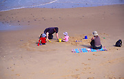 AMFXF3 Family playing sandy beach Cromer Norfolk England