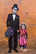 A father and daughter dressed as calaca and La Calavera Catrina during the Day of the Dead festival November 1, 2016 in San Miguel de Allende, Guanajuato, Mexico. The week-long celebration is a time when Mexicans welcome the dead back to earth for a visit and celebrate life.