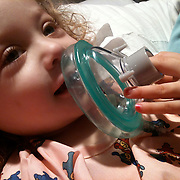 On December 27, 2012 two year old Holly Larue Frizzelle was diagnosed with Acute Lymphoblastic Leukemia. What began as a stomach ache and visit to her regular pediatrician led to a hospital admission, transport to the University of North Carolina Children's Hospital, and more than two years of treatment. Holly Larue Frizzelle, 2 plays with some of the items commonly encountered during surgery in her room at UNC Hospital in December 2012. The hospital staff allow children to play with the items to make them more comfortable before they have surgery.