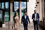 Corporate employees walking to a meeting in the commercial centre of St Helier, Jersey, Channel Islands