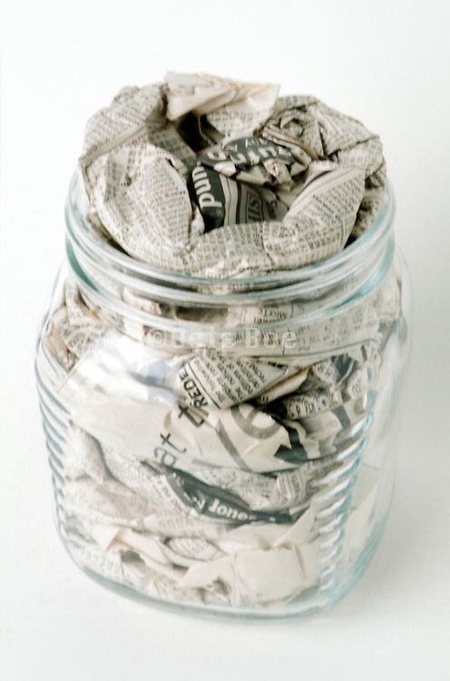 glass jar stuffed with newspaper