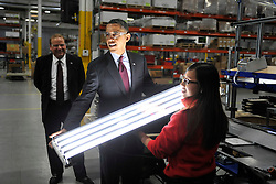 U. S. President Barack Obama tours Orion Energy Systems, Inc. in Manitowoc, Wisconsin on January 26, 2011. President Obama, Vice President Joe Biden and other members of the President's Cabinet traveled across the country Wednesday to highlight the administration's efforts to rebuild the American economy. Photo by Brian Kersey/UPI/ABACAPRESS.COM  | 261280_005 Manitowoc Etats-Unis United States