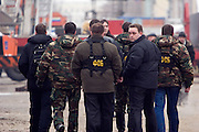Moscow, Russia, 23/02/2006..Officers of the Federal Security Service [FSB] at Baumanskii Market in eastern Moscow after the market roof collapsed, apparently under the weight of snow, killing many people.