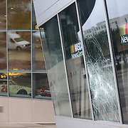 Charlotte, NC- September 22, 2016: A broken window can be seen at the NASCAR Hall Of Fame . The damage was caused by provacateurs the evening before. Protests continue in Charlotte after the shooting death of Keith Scott. CREDIT: LOGAN R CYRUS FOR THE NEW YORK TIMES