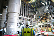 Plant manager Dan Rutledge looks on in an air exchange area at the Puris pea protein processing facility in Dawson, Minnesota, on Tuesday, June 8, 2021.