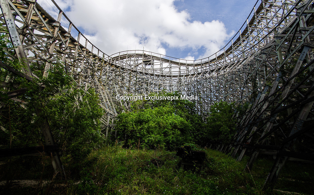 """Abandoned Dania Beach Boomers and Hurricane Rollercoaster<br /><br />The Dania Beach Hurricane is a wooden roller coaster at Boomers! in Dania Beach, Florida.<br /><br />It was designed by Jules Ross and the Stand Company and was built by Coaster Works, Inc. The Dania Beach Hurricane opened on November 1, 2000 and at 3,200-feet-long, 100-feet-tall, the coaster was the largest wooden roller coaster in Florida. Despite being located at the Boomers!, it was owned and operated separately by Dania Woody LLC.<br /><br />The roller coaster closed in April 2011. The following statement was posted to the Boomers! website:<br /><br />""""We have been informed that the third party who owns and operates the wooden roller coaster adjacent to the Boomers Family Fun Center in Dania/Ft. Lauderdale, Florida has ceased operations effective immediately. The closure of the roller coaster does not and will not affect the operations of the Boomers Family Fun Center.""""<br />Dania Woody LLC cited """"business reasons"""" for ceasing operations but it's thought that the high cost of maintaining a wooden roller coaster in Florida's warm climate and low ridership may have been a factor. It was later stated that the company had filed for bankruptcy.<br /><br />After it's closure, Dania Woody LLC attempted to find a non-profit to either take the coaster away to renovate and run elsewhere, or pay to take down the coaster in exchange for owning the salvage parts. They had no luck.<br /><br />In August 2014, it was reported that the Aventura-based developer, Master Development, had a contract on the land to build a development which will include shops, a hotel, restaurants and apartments.<br /><br />Boomers! closed down on January 25, 2015. Developers are planning a complex they're calling The Landings at Dania Beach, a $250 million-plus project including big-box retail stores, casual and formal restaurants, at least one hotel, apartments and possibly condos and offices. It is a joint venture of Master Deve"""