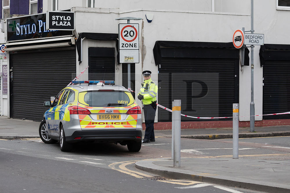 © Licensed to London News Pictures. 22/03/2017. LONDON, UK.  A police officer at the top of Bedford Road, with the junction of Ilford Lane. A man has died after being shot in Ilford, east London. Police were called to reports of a shooting at the junction of Ilford Lane and Bedford Road in Ilford at 22:10 last night. Emergency services found the victim, a man unconscious with a gunshot wound and he died shortly after.  Photo credit: Vickie Flores/LNP