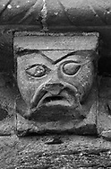 The Stone Bestiary - Black and white photo art print of Norman Romanesque exterior corbel no 56 - sculpture of a stylised head of a human. The Norman Romanesque Church of St Mary and St David, Kilpeck Herefordshire, England. Built around 1140 .<br /> <br /> Visit our LANDSCAPE PHOTO ART PRINT COLLECTIONS for more wall art photos to browse https://funkystock.photoshelter.com/gallery-collection/Places-Landscape-Photo-art-Prints-by-Photographer-Paul-Williams/C00001WetsxVxNTo