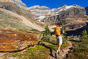 Hiker on the Yukness Ledges Trail at Lake Oesa, Yoho National Park, British Columbia, Canada