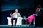 MUMBAI, INDIA – JANUARY 16, 2020: Amazon president Jeff Bezos participates in a fireside chat with filmmaker Zoya Akhtar and actor Shah Rukh Khan. Many Bollywood celebrities were in attendance at the blue carpet event, which was organized by Amazon Prime Video.