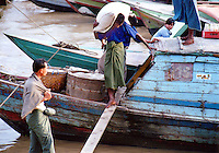 BURMA (MYANMAR) Yangon Division, Yangon. 2006. Much of what can be done by hand is done so. Boats and river transport are crucial to the crippled Burmese economy.