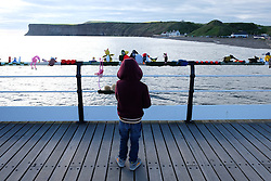© Licensed to London News Pictures.<br /> 22/05/15<br /> <br /> Saltburn, UK. <br /> <br /> Bodhi Nary, 5, from Saltburn looks at the knitted figures attached to the pier after the Saltburn Yarn Bombers struck again during the early hours of the morning. The secret group fastened knitted figures that represent, on the year marking the 150th anniversary, characters from Lewis Carroll's classic children's book Alice's Adventures in Wonderland. <br /> <br /> Photo credit : Ian Forsyth/LNP