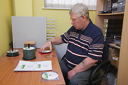 Man who has lost use of arm due to a stroke, running an audio duplicating service, helped into employment by the Ready 4 Work team, Nottinghamshire County Councilork