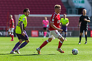 Bristol City's Taylor Moore (23) under pressure from Exeter City's Ryan Bowman (12) during the EFL Cup match between Bristol City and Exeter City at Ashton Gate, Bristol, England on 5 September 2020.
