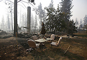 Patio furniture remains relatively untouched after a wildfire swept through the community on White Rock Road, destroying several houses, in Okanogan, Wash., Sunday, August 23, 2015.<br /> <br /> Sy Bean / The Seattle Times