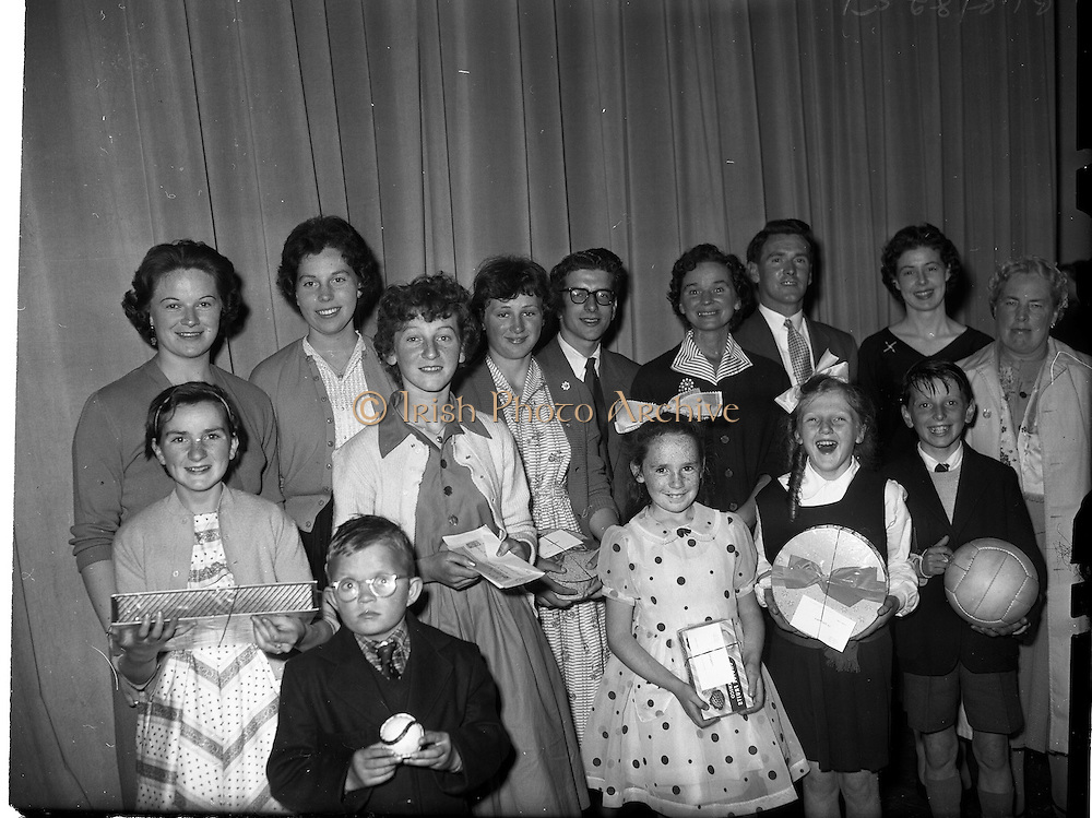 22/05/1959<br /> 05/22/1959<br /> 22 May 1959<br /> Gael Linn Singing Competition at the Dominican Convent, Dun Laoghaire. Group of prize-winners with their prizes and the adjudicators and organisorrs of the Gael Linn Concert and singing contest.